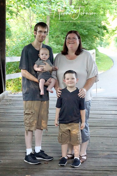Cute family outdoor photo on covered bridge in wilmington ohio